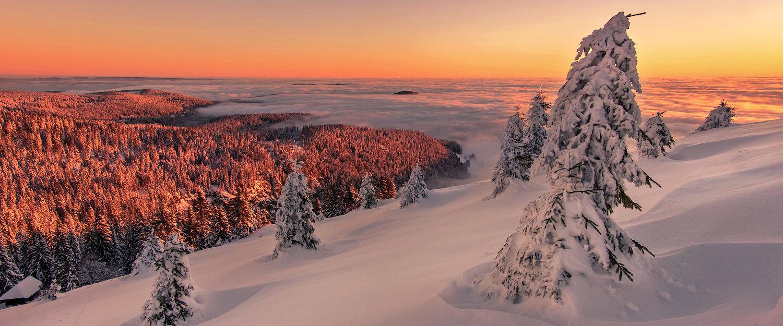 Schneelandschaft im Sonnenaufgang